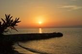 zapad slunce-pohled z vily Theo